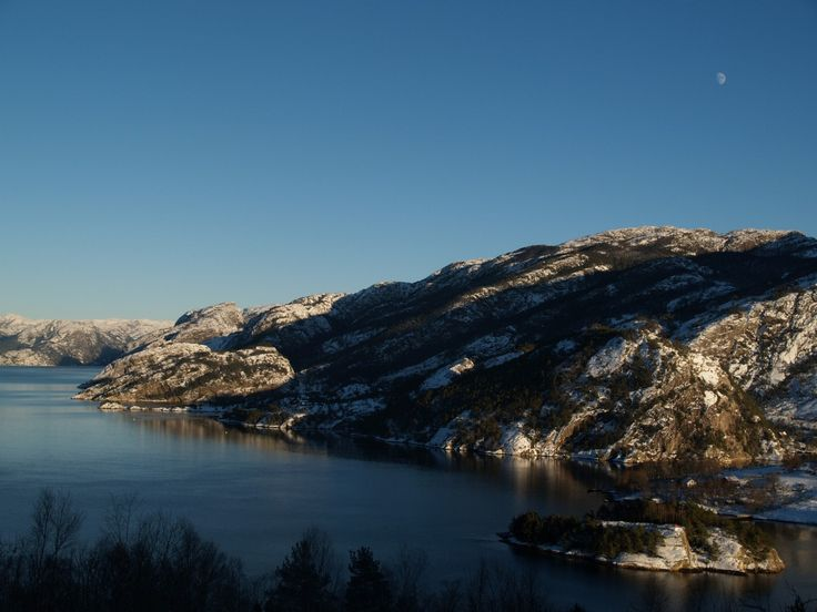 Lysefjorden, Forsand, Norway. Snow on the mountains - and the moon - not full yet, but just a few more days to wait. January 19th 2016