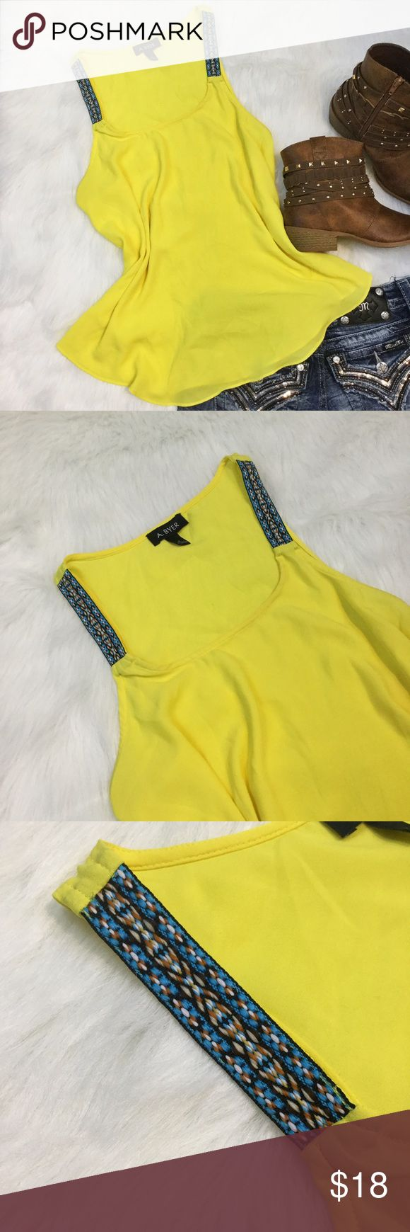 Sheer yellow tank top Sheer yellow tank top with thread print straps in he front. A. Byer Tops Tank Tops