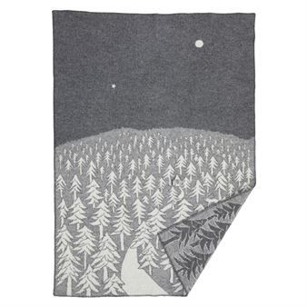 House in the Forest is a rug by Japanese designer Akira Minagawa for Klippans Yllefabrik. The design - a house in a pine forest that leads to a narrow road - is available in various color combinations.