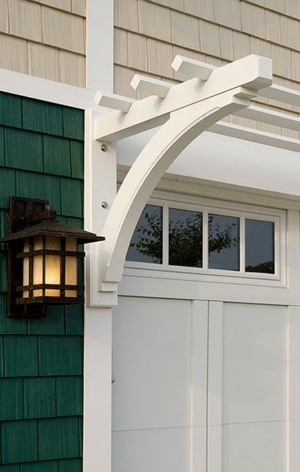 Garage detail: Carriage house door, arbor and light fixture. Clopay Coachman Collection garage door, Design 11, REC14 windows.