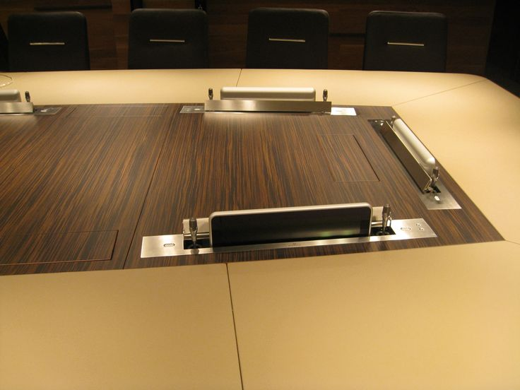 Both the screen and the microphones disappear within the table desk when no needed