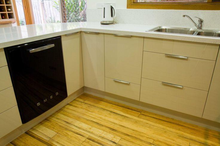 Small contemporary kitchen with black retro Smeg appliances. www.thekitchendesigncentre.com.au