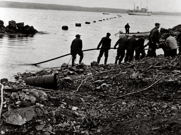 The first trans-Atlantic telephone cable, completed in 1956, where it entered  shallow water off the coast of Newfoundland.