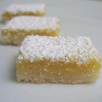 lemon bars   Crust:  1 can coconut macaroons  1/4 cup melted margarine  Filling:  1 1/2 cups sugar  4 eggs  1/2 cup lemon juice  2 tablespoons potato starch  1 teaspoon baking powder  1/4-1/2 cup powdered sugar for dusting