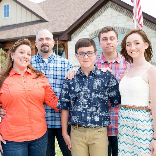 The Coffey Family Home Grand Reveal: The Coffey Family stand in front of their new, mortgage-free home built by Henley Homes, a Southern Living Custom Builder Member, in Liberty Hill, TX.