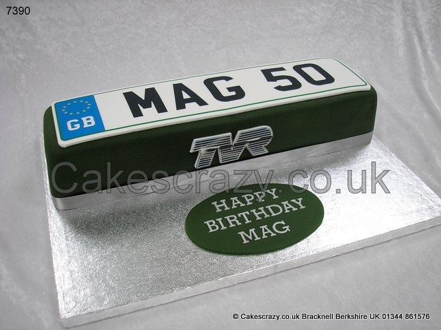 Number Plate Cake.Vehicle number plate celebration cake finished in racing green, but any colour to suit, personal licence plate number or message as required, and edible manufacturers logo on the side. Choose a colour, message, and marque