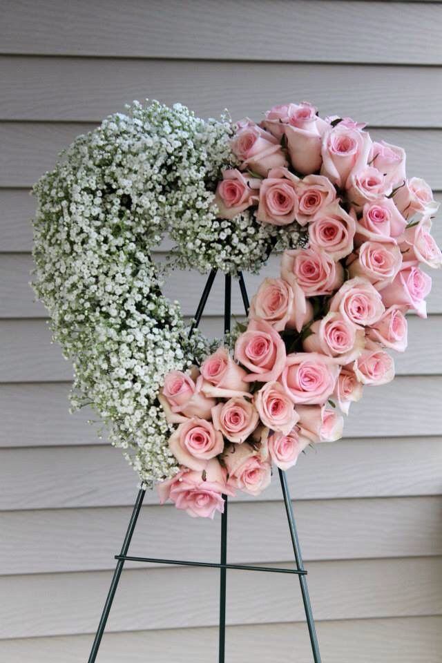 Baby's breath and rose open heart...... but with wild flowers please!