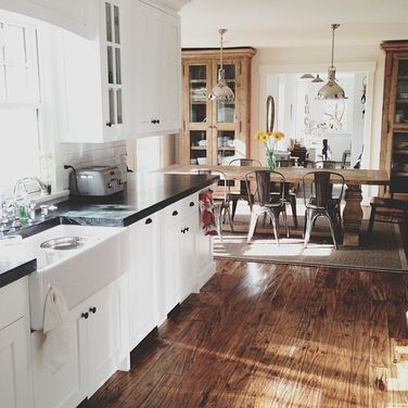 Your Photos: Kitchen Scenes on Food52.  Kitchen dining combo ideas. Love the black soapstone counterops.