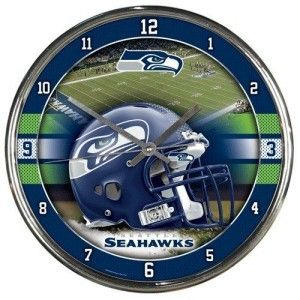 This Seattle Seahawks football wall clock keeps accurate time while nicely decorating the home, office, or game room of any fan of NFL team Seattle Seahawks.