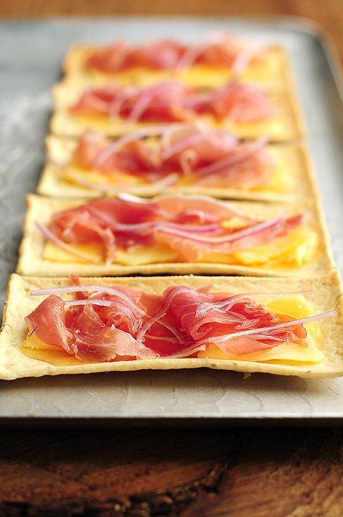 Ingredients  flatbread crackers (I used rosemary flatbread crackers.)   gouda, thinly sliced   prosciutto   red onion, thinly sliced   enough honey for drizzling  Instructions  Layer the gouda, prosciutto, red onion on the flatbread crackers, drizzle with honey, and watch them disappear.