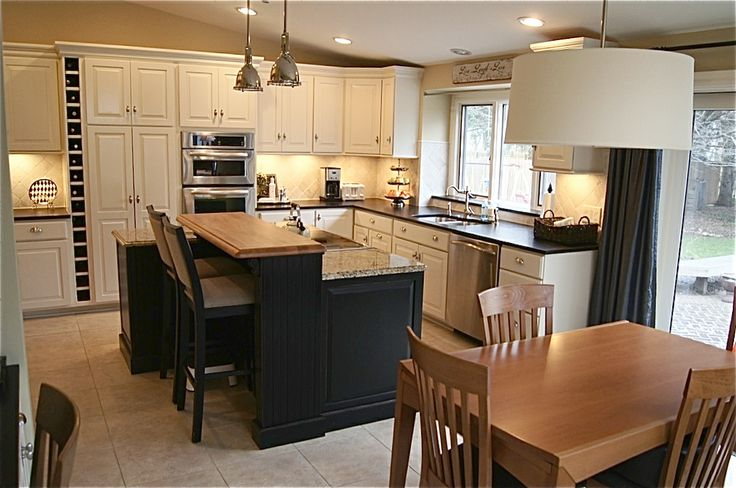 The Yellow Cape Cod: Dramatic Kitchen Makeover~Before and After.  Love the lights.  Remind me of the Biltmore swimming pool area from the turn of the century.