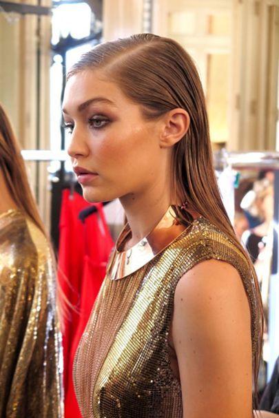 Gigi Hadid models the hair backstage at Balmain SS17