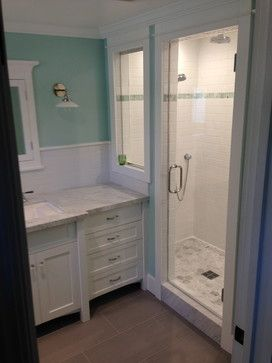 Craftsman bathroom subway tile shower with window.