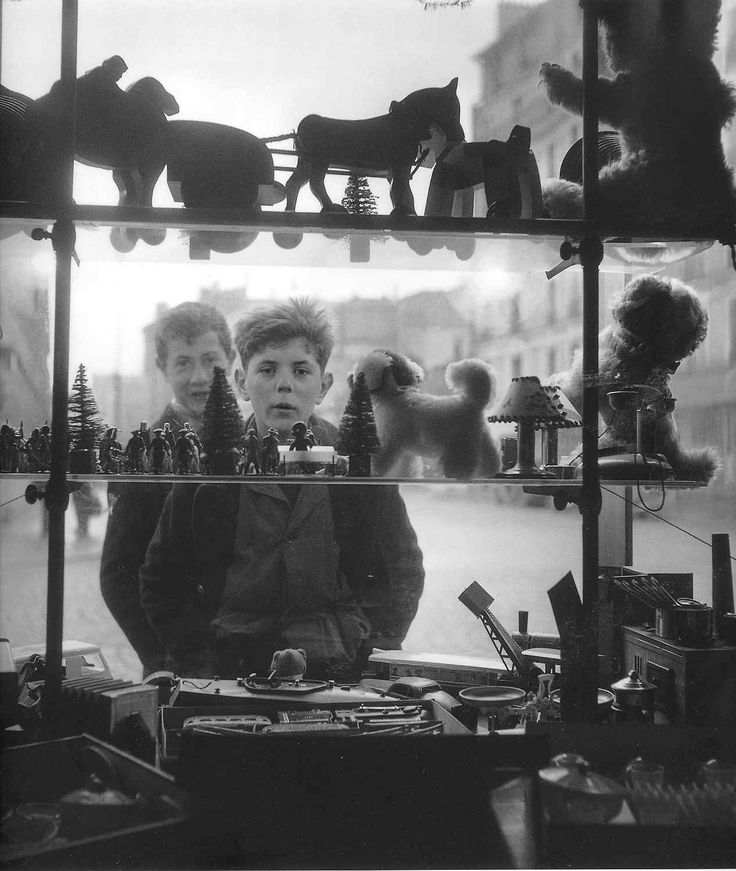 Robert Doisneau - Window - one of my favorite photographers. If you are ever in France have a change to see one of his exhibits, by all means go!