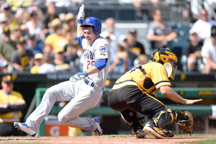 Szczur scores big:    Matt Szczur of the Cubs scores past Pirates catcher Eric Fryer during the eighth inning on July 10 at PNC Park in Pittsburgh.