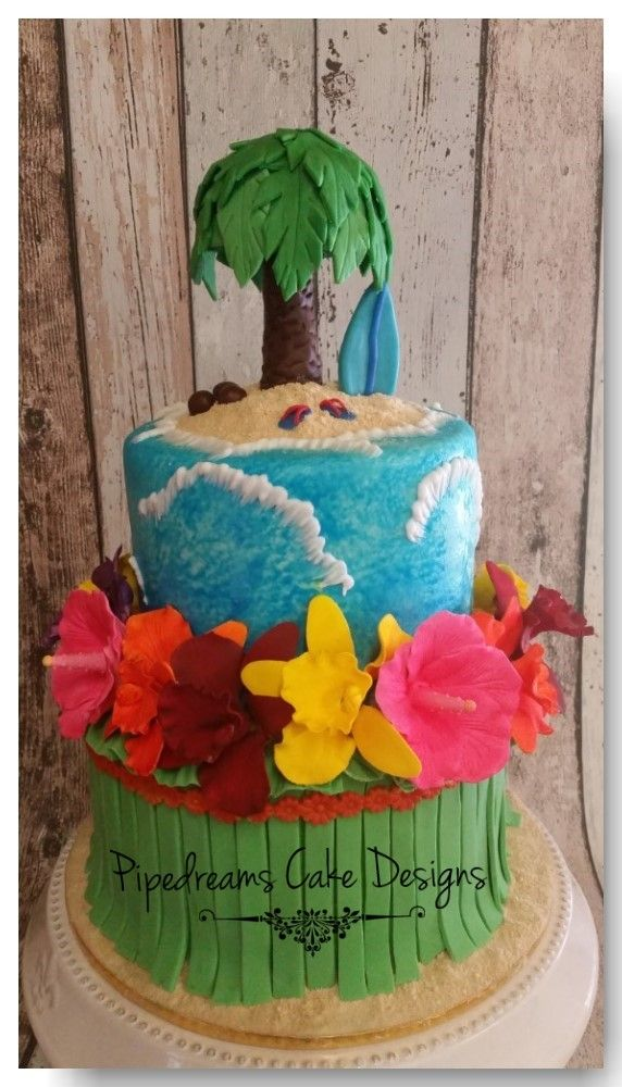 Here is a cake for paradise. This 2 tiered cake features a hula skirt topped with bright tropical flowers, the top tier has brush embroided waves topped with edible sand, thongs , surfboard and of course a palm tree with 2 coconuts. I loved the bright colours and fun feel of this cake.