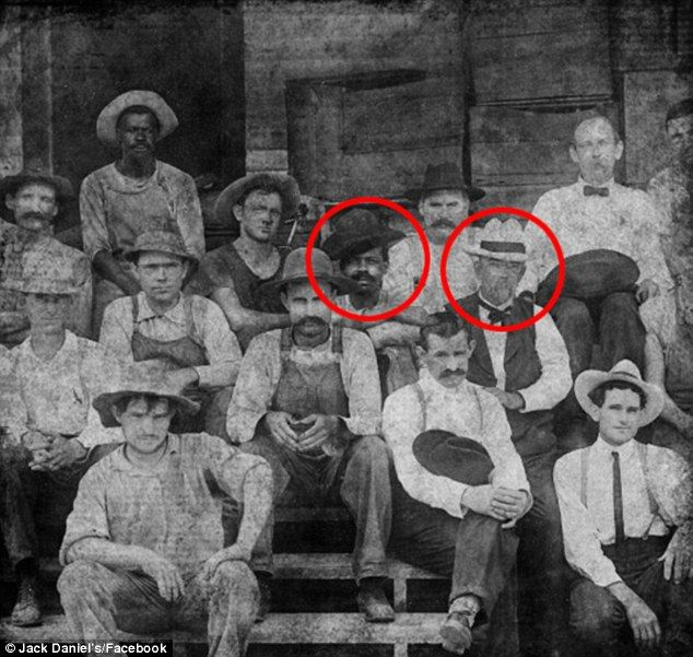 After 150 years, Jack Daniels has finally revealed that a slave was behind the world-famous recipe of America's most popular whisky. A photo taken from the time shows a man thought to be one of Nearis Green's (the slave who passed on the recipe) sons sitting on the left of founder Jack Daniel (circled, right) and his workers