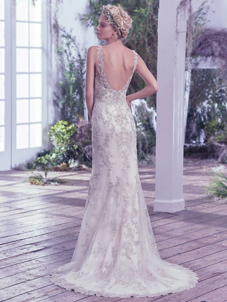 Maggie Sottero - GREER, This bead embellished vintage-inspired wedding dress features Swarovski crystals. The illusion straps and plunging V-neckline add statement-making glamour to this sheath gown. Finished with stunning scoop open back and zipper closure.