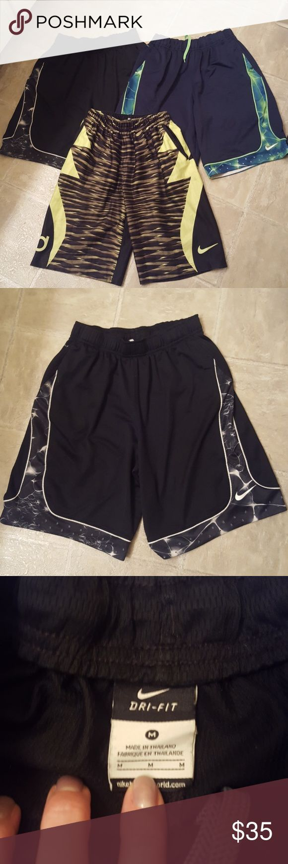 3 Pair Nike Dri-Fit Shorts 3 pairs of Nike shorts. Used but in good condition. Black pair is near flawless, navy pair has a few snags on trim color as in photos and black/neon green shorts have a few snags on the butt from my son sitting on a concrete wall. Please zoom in on photos so i know youll be happy with your purchase! Still plenty of life left in all of these! Nike Bottoms Shorts