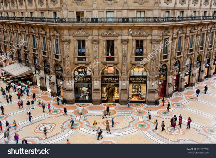 MILAN, ITALY - MAY 2: Unique view of Galleria Vittorio Emanuele II seen from above in Milan on May 2, 2012. Built in 1875 this gallery is one of the most popular shopping areas in Milan.