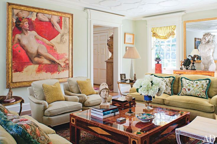 The living room displays an unfinished 19th-century canvas by Carolus-Duran; the armchairs, sofas, and cocktail table are by Timothy Corrigan Home.