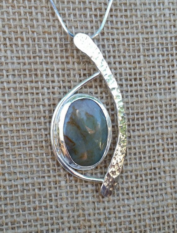 "This Sterling Silver Pendant is approx. 2-3/4"" long and 1-1/4"" wide. It has a 30 mm x 20 mm Pale Green Color Agate Cabachon as the focal point. $125.00 By uniqjewelrybymarc"