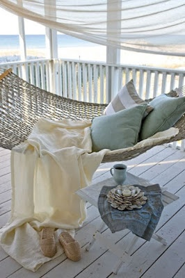 A beach view and a porch with a hammock. Heaven!