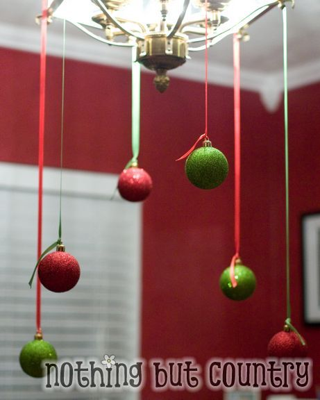 This is a pretty option for home holiday decor. But if you work for a company that allows employees to decorate their offices for the holidays, consider using this festive idea for decorating your office. Use simple thumb tacks to hang pretty ornaments strung on ribbons from the ceiling tiles.