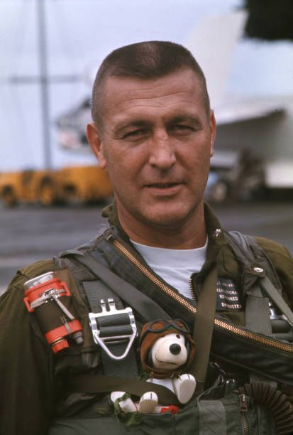 Unidentified US pilot aboard an US Navy aircraft carrier during Vietnam in the Gulf of Tonkin the pilot is wearing Snoopy stuffed animal clipped to...