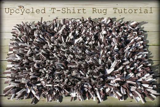 "* Rug made from rows of t-shirt strips sewn to a towel. Less time-consuming than the latch-hook t-shirt rugs with the same look.     Cut strips 1 1/2"" or wider, takes less time that way."