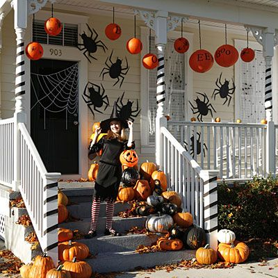 Black silhouettes and hanging lanterns seem easy enough.  All those pumpkins could get expensive though.
