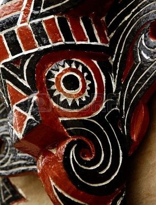 View of a detail of a Batak house ornament in Sumatra. Geometrical lines for the representation of a traditional mask photo