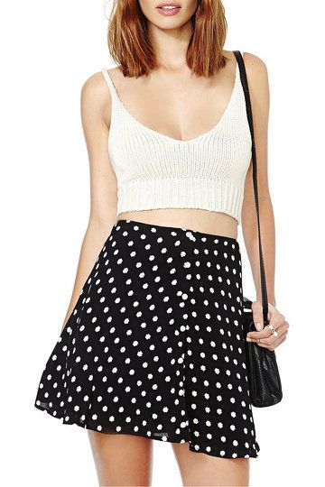 For summery daytime looks try this small flower print skater skirt paired with a white vest top and tan block heel sandals.
