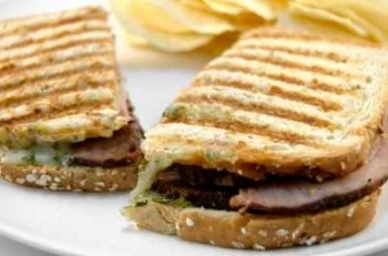 This recipe is the one to choose if you want to make a gourmet Panini sandwich. Featuring delicious tender roasted pork as well as cheese and BBQ sauce, this makes an outstanding lunch. The pork loin is marinated first and then roasted to perfection. Cover it with aluminum foil after roasting to allow the juices to settle.