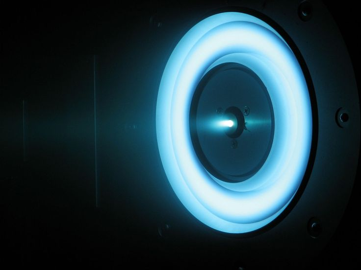 The engine in the photo, blue with the glow of xenon gas, is being considered to become a part of NASA's Asteroid Retrieval Initiative, a proposed program to robotically capture a small near-Earth asteroid and redirect it to a stable orbit around Earth. S