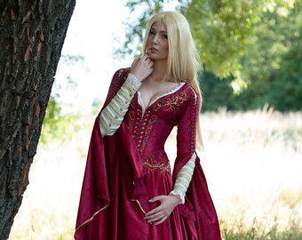 Un vestido de fantasía medieval para una doncella de hadas. Nos hemos inspirado en el Señor de los anillos y juego de diseños de tronos, intentando crear un atuendo perfecto para una fantasía de señora. Este tipo de vestido podría usar fácilmente por Margaery Tyrell o Sansa Stark en los jardines de verano de desembarco del rey. El vestido está decorado con mano teñida de color similar a la guarnición de oro en las mangas de encaje.  Las mangas enormes ellos mismos inspiradas en las pinturas…