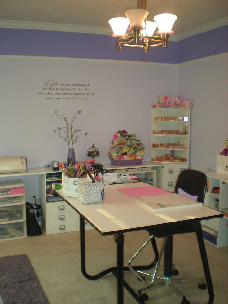 This is not My Scrapbook Room! But you can find out whose it is by going here - Scrapbook.com I just repinned it =)