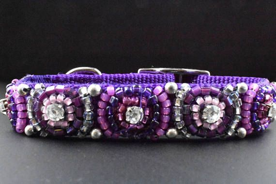 Purple dog collar is embellished with various shades of purple seed beads. Petite round rhinestones are centered artistically along the middle of the collar. You definitely wont be barking up the wrong tree purchasing this glamorous purple beaded collar. No matter where you and your dog are going or no matter what color its fur is, your pawsh pup will look strikingly stylish. An extra small collar is pawfect for a puppy or tiny dog. Spoil and wow your bow-wow today by heading to the dog park…
