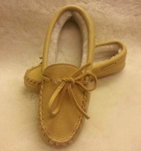 Ladies moosehide moccasin with 100% genuine sheepskin lining. Durable rubber sole. Proudly made in Canada by Laurentian Chief.