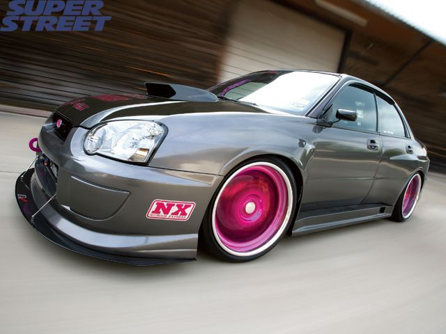 2004 Subaru WRX STI. I want a black one, hatchback with pink works.