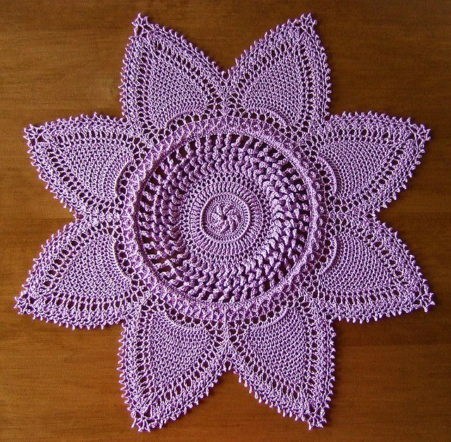 "from Patricia Kristoffersen Crochet Originals ""Victorian Spiral Doilies"" by Patricia Kristoffersen DMC Cebelia Crochet Cotton, Size 10 color: #210 Violet 16-3/4 inches using a size 5 (1.90mm) steel hook"