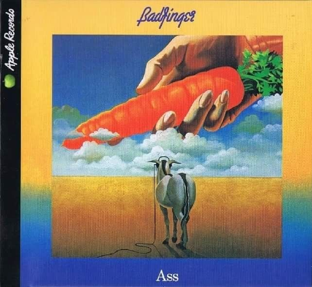"Released November 26th, 1973 ""Ass"" Is The 4th, Studio Album By The British Rock Group Badfinger & Their Last Album Released On Apple Records. The Opening Track ""Apple Of My Eye"" Refers To The Band Leaving The Label To Begin It's New Contract With Warner Bros. The Cover Artwork, Showing A Donkey Chasing A Distant Carrot, Alludes To Badfinger's Feelings That They Had Been Misled By Apple Over The Years. Cover Art By Grammy Award Winning Artist Peter Corriston."