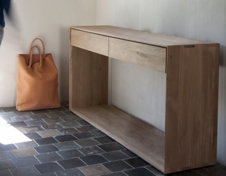 "Ethnicraft Oak Console from Lekker Home | Remodelista. Reference for window ""box wrap"""