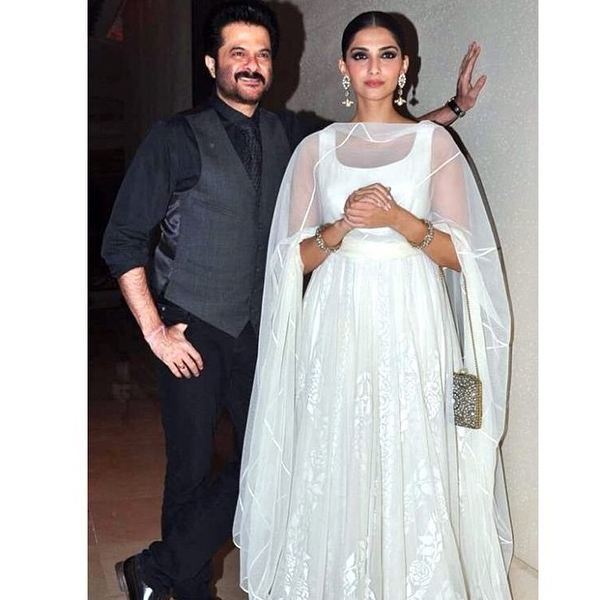 Beautiful #Sonam Kapoor with her daddy.  Bored from Dark color lehangas,  saree and other outfits???  This time try something light color. She is looking beautiful and simple in her White Anarkali Suit. :)   Try this once. Be Simple Be Beautiful