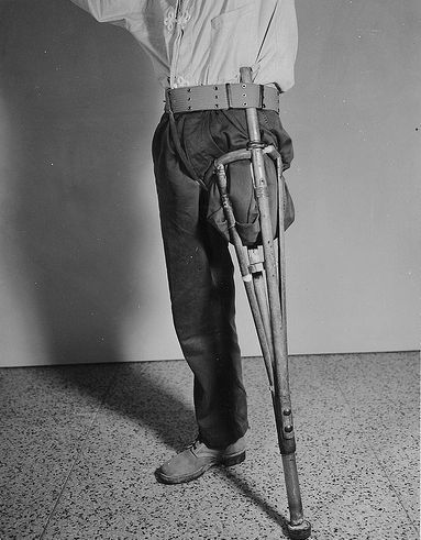 Demonstrate a prosthesis of a mid thigh amputation. The prosthesis was manufactured from materials available to the patient while he was a prisoner under the Japs / Otis Historical Archives Nat'l Museum of Health & Medicine