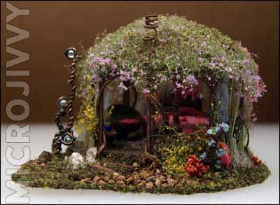 This is incredible.  This is the faerie house I DREAM of making.  Just perfect.  Definitely click the image to go to the original page.  There are way more pictures, and you can see how tiny this house really is.