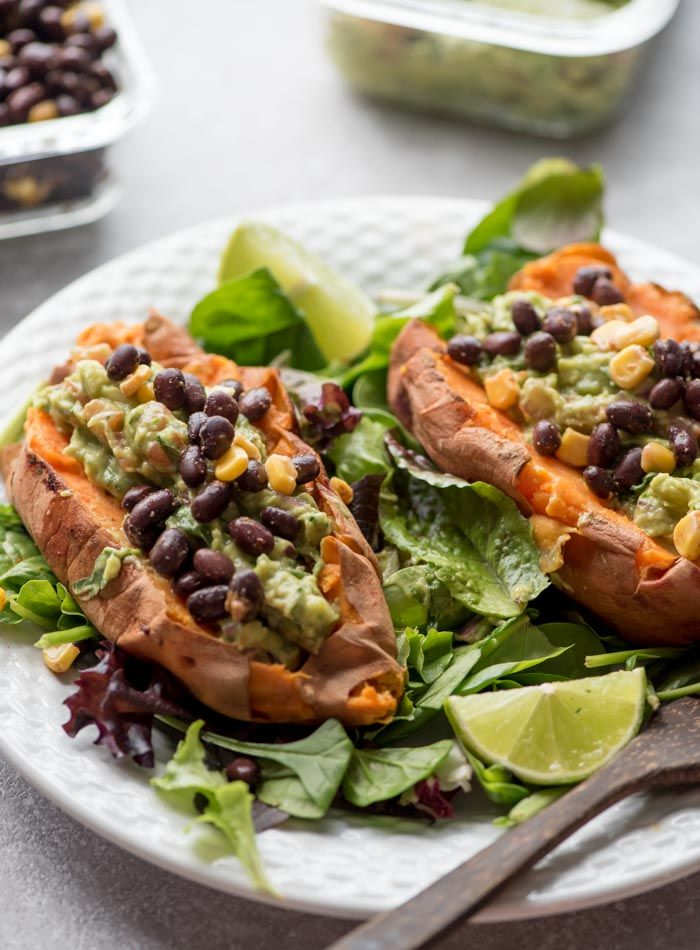 Guacamole Stuffed Sweet Potatoes with Black Beans - guacamole (ripe avocados, fresh lime juice, red/white onion, garlic cloves, tomato, jalapeno [optional], fresh cilantro, sea salt), sweet potato, black beans, optional toppings (corn, chipotle sauce [includes recipe link], salsa, vegan sour cream, lentil taco meat [includes recipe link])