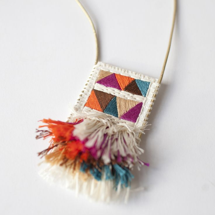 This necklace calls to mind an ancient relic, a rich wall hanging or some sort of talisman. Hand-embroidered on muslin and attached to a sturdy felt backing, this adjustable leather-corded necklace will set you apart.Artist: An Astrid Endeavor