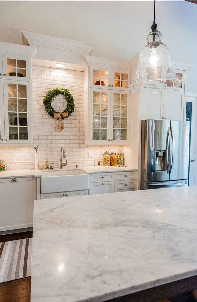 subway tile kitchen - marble counter. Cottage kitchen..needs a bit more color, bit I like