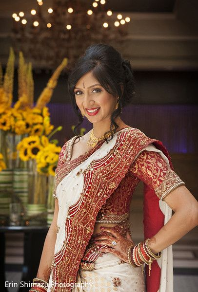 Traditional Indian bride wearing bridal saree, jewellery and hairstyle. #IndianBridalMakeup #IndianBridalFashion